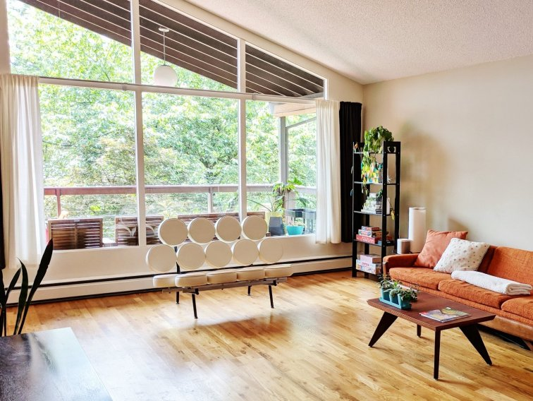 Mid-century modern living room after installing hardwoods