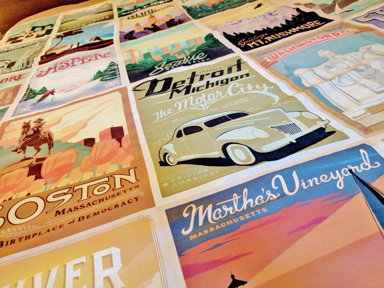 Vintage travel poster bedding for retro guest room