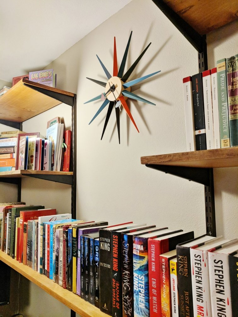 Mid-century modern shelving unit filled with books