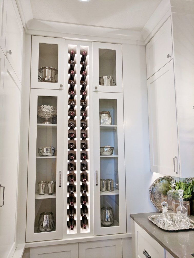Pantry with wall of wine storage