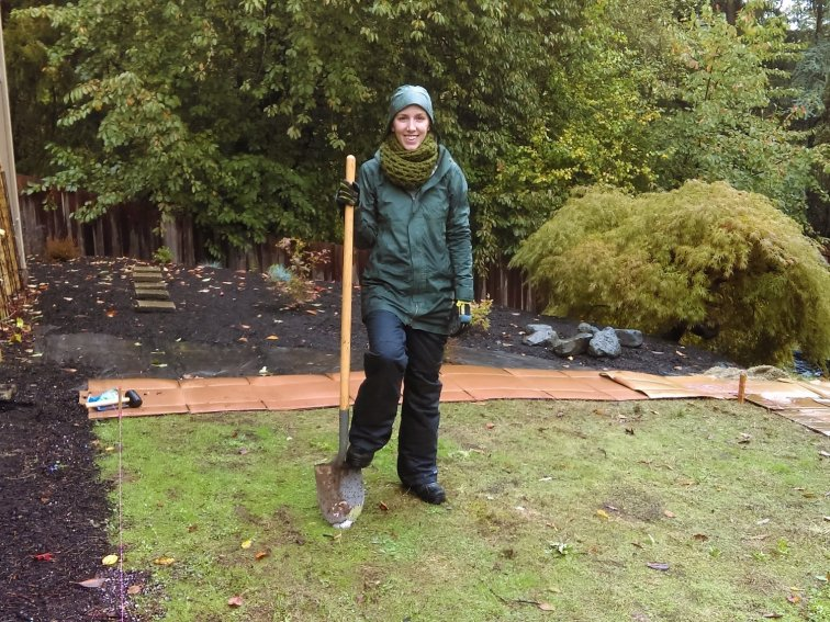 Don't be fooled by the smile. Landscaping a fixer upper means digging holes in the late autumn rain in snow pants to keep from freezing while your fingers almost break off.