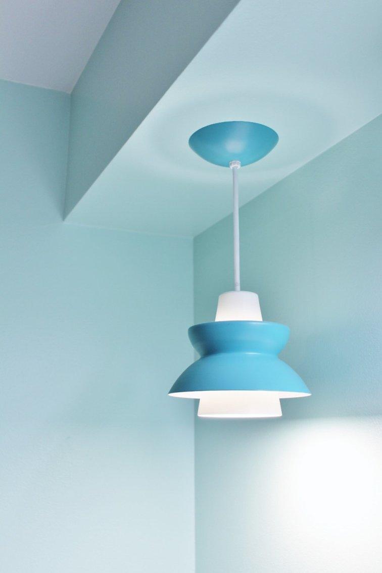 Mid-century modern pendant lamp in aqua bathroom