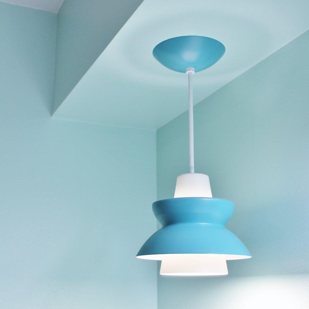 Turquoise pendant light in modern bathroom