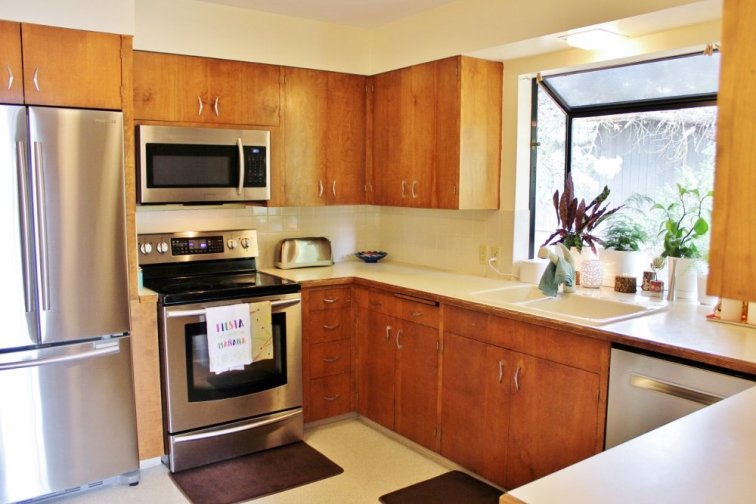 Retro 1960s kitchen with wood cabinets