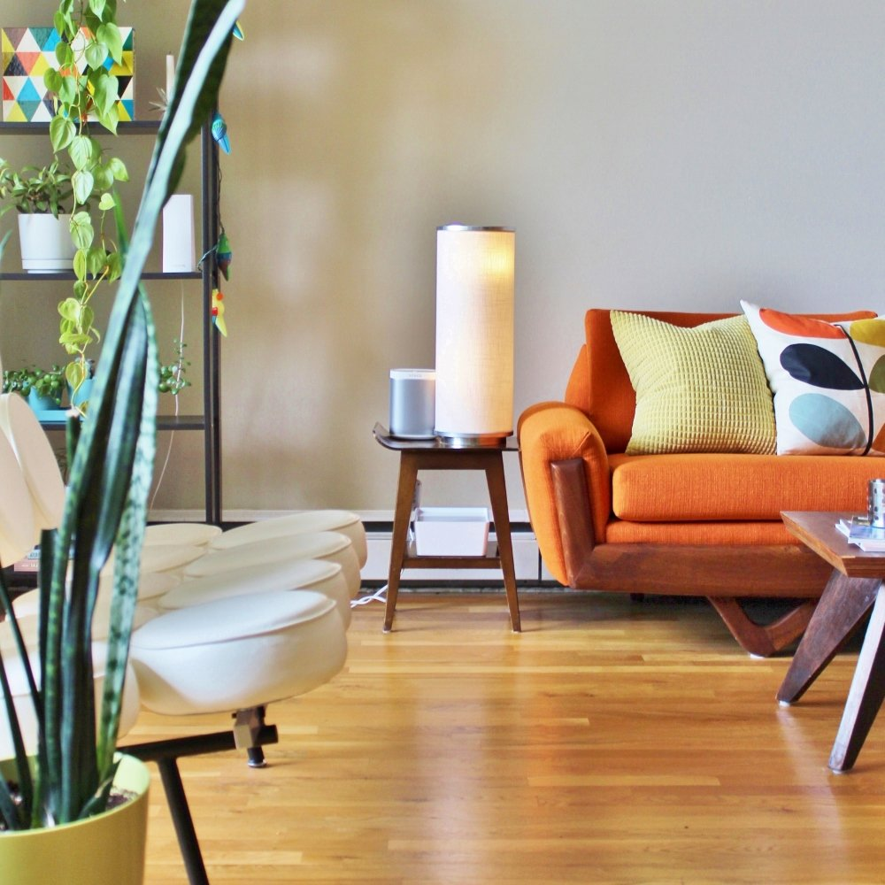 1960s modern living room with orange sofa
