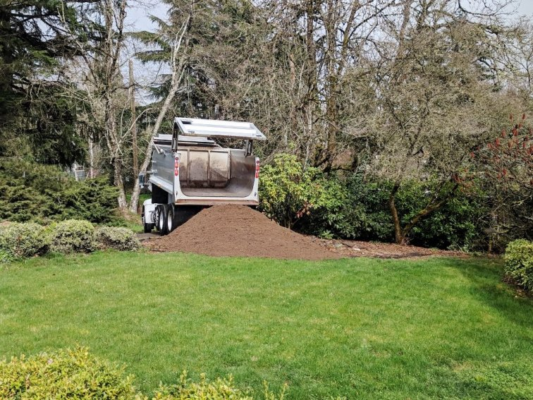 One unit (7.5 yards) of dirt getting delivered to build a landscaping berm