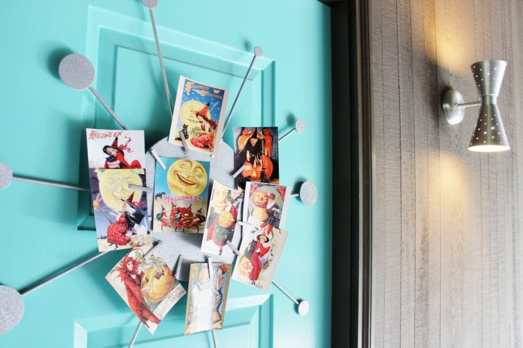 Display retro witch pinup postcards on a wreath to give your front door a mid-century makeover.