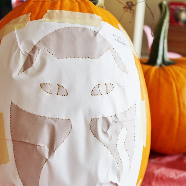 Carving a mid-century modern cat pumpkin with a stencil