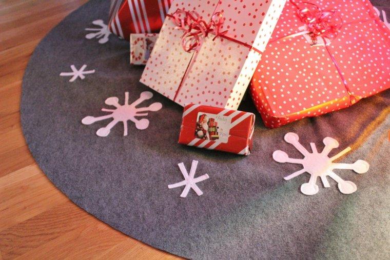 Festive gifts on a retro Sputnik tree skirt