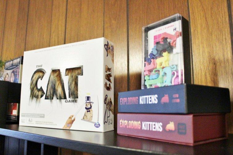 Cat board games displayed on shelf