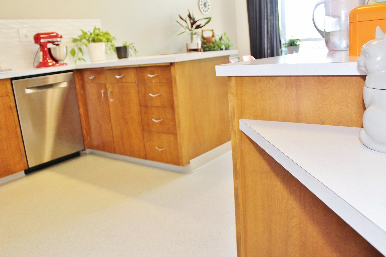 SparkleLam white laminate countertops with silver glitter in 1960s kitchen