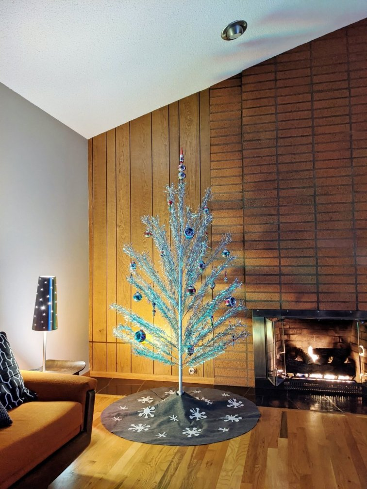 Shiny Brite ornaments on aluminum Christmas tree in mid-century modern living room