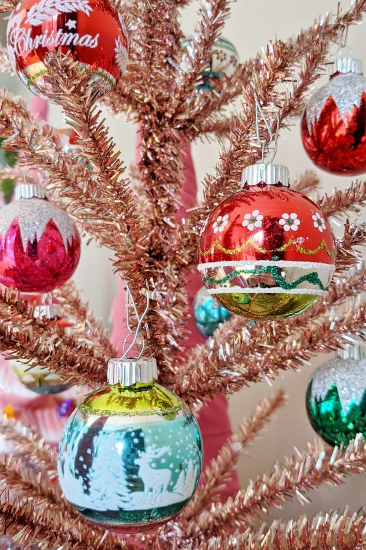 Pink tinsel tree with mini Shiny Brite ornaments