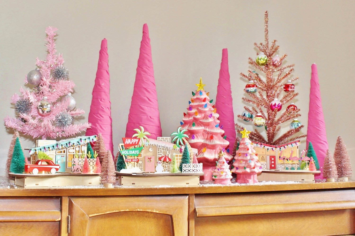 Pink Christmas trees and retro holiday village display