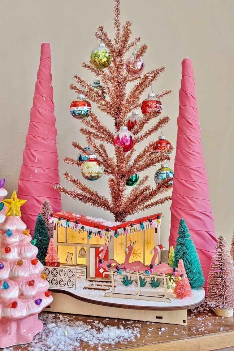 Pink tinsel tree and retro Christmas house