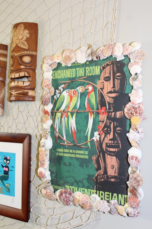 Retro Disney Enchanted Tiki Room poster in tiki bar on gallery wall