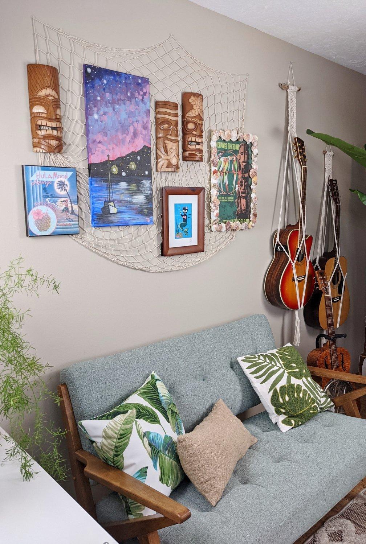 Tiki bar loveseat and gallery wall