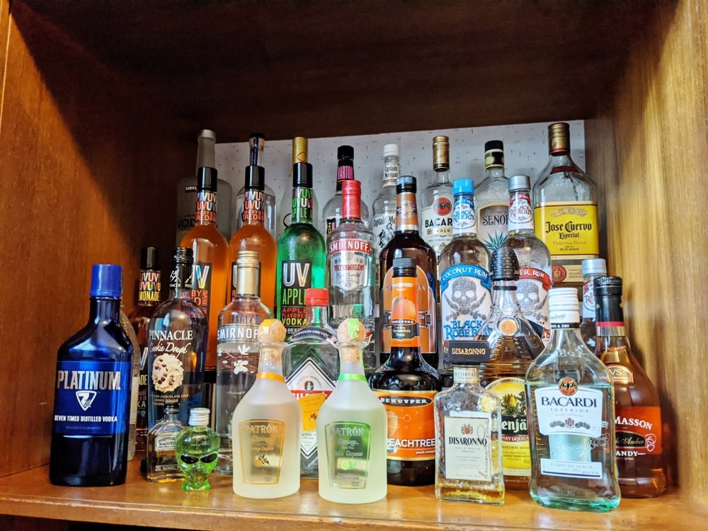 Liquor cabinet display with risers