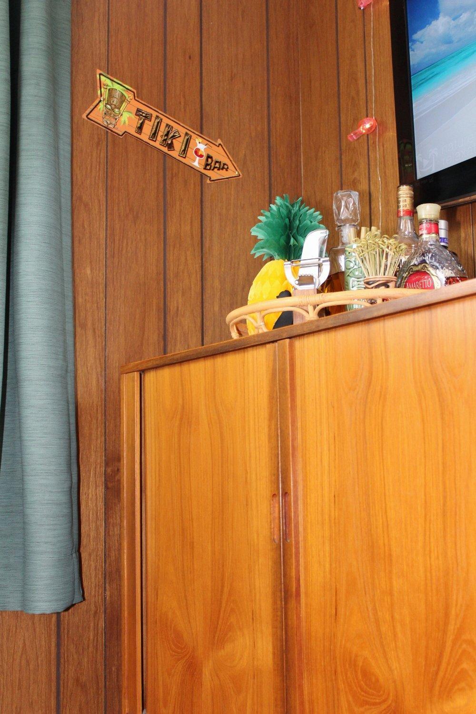 Mid-century modern liquor cabinet and tiki bar sign