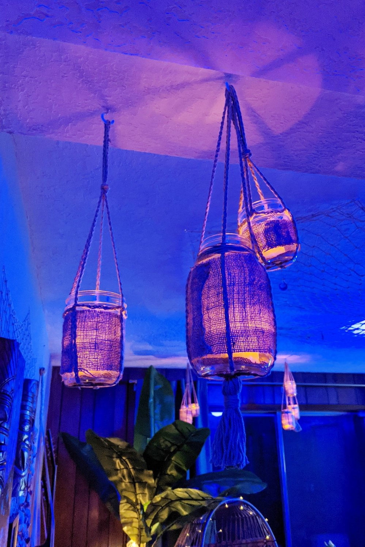 Amber candles flickering in tiki bar lanterns