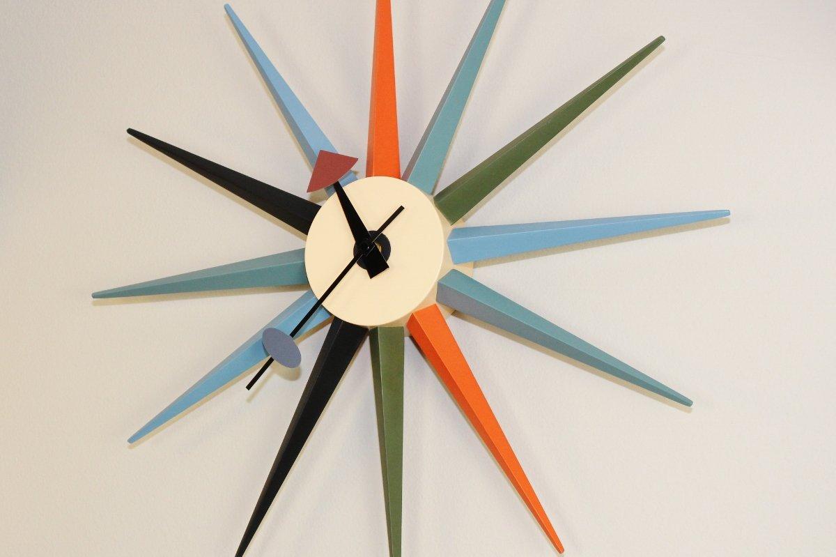 Starburst wall clock in mid-century modern home office