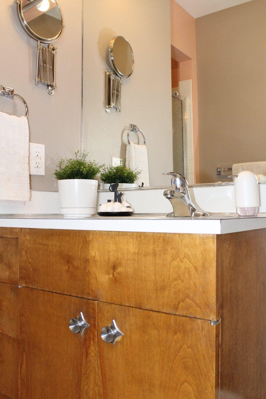 Walnut bathroom cabinet with white accessories