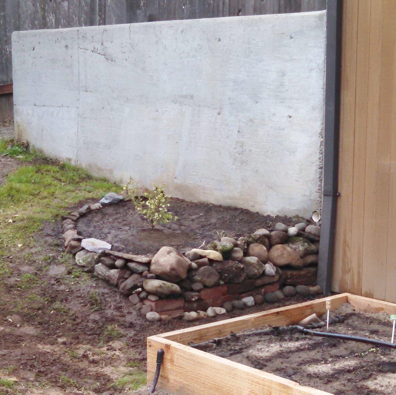 Loose stacked stone garden planter