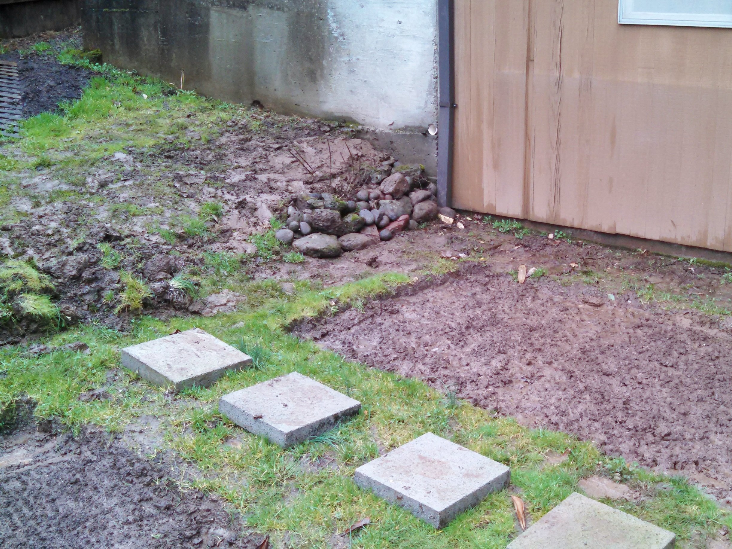Sad pile of rocks before we built our retaining wall planter