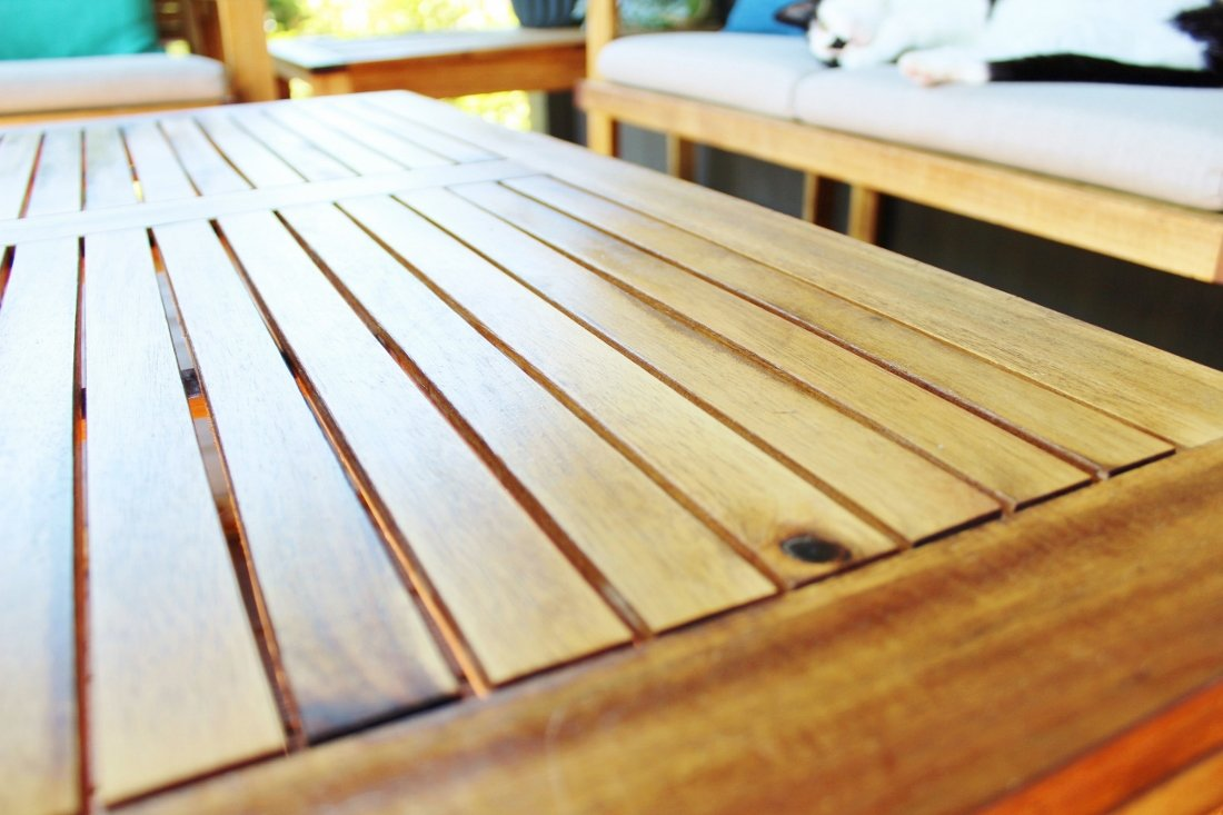 Outdoor coffee table restored with teak oil