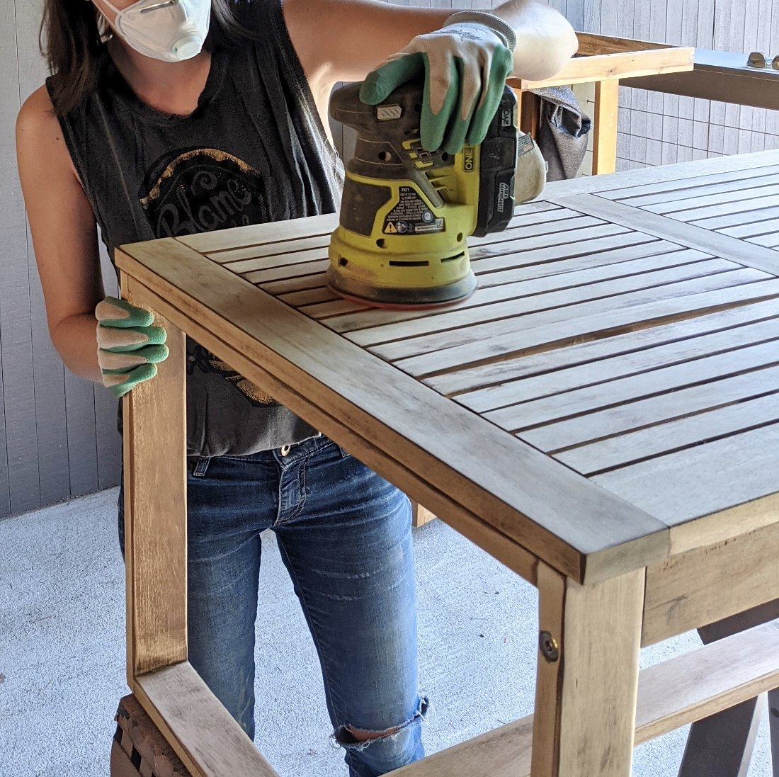 Sanding wood outdoor coffee table to prep for teak oil application