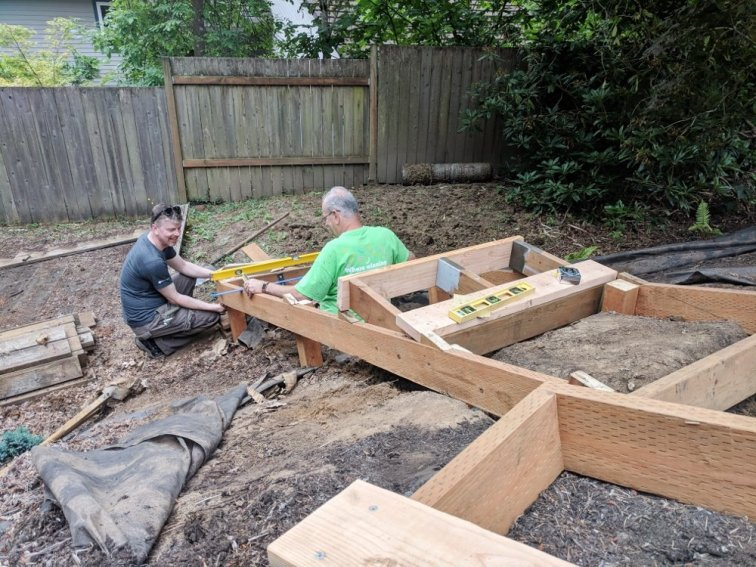 Eric and his dad building stairs to the future deck