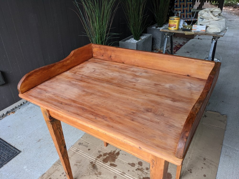 Wood desktop after first coat of stain