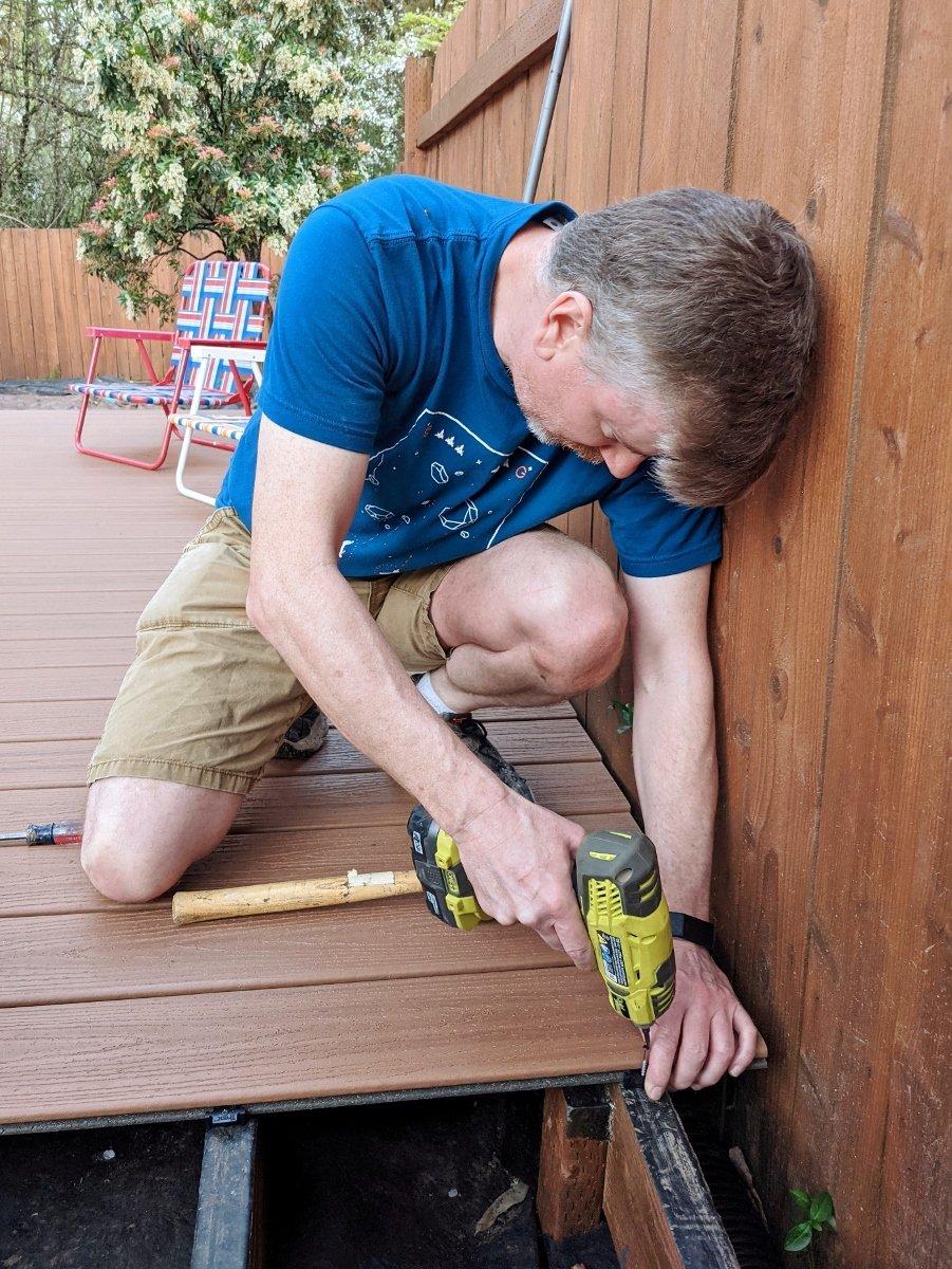 Installing hidden fastener against grooved Trex board