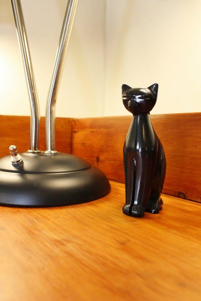 Mid-century cat figurine on wood desk