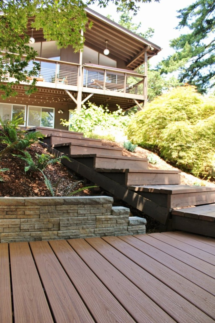 Trex deck, stairs and retaining wall in newly finished deck area