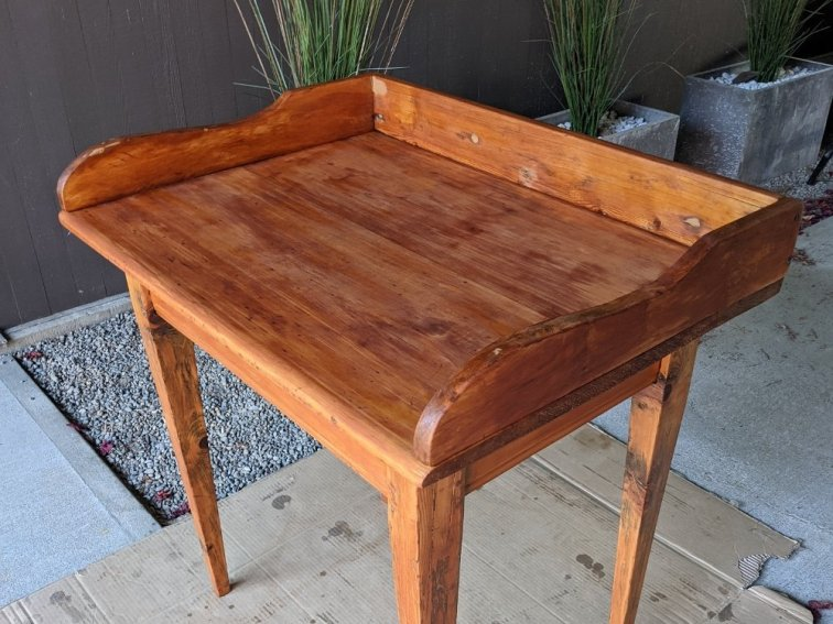 Desk with one coat of stain and noticeable wood filler marks