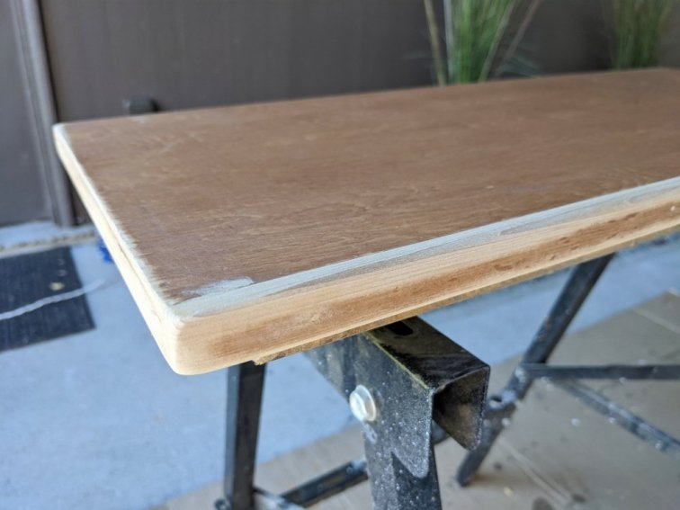 Sanding shelf to get ready for painting