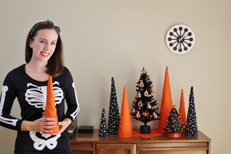 Collection of orange, black and white Halloween trees on display