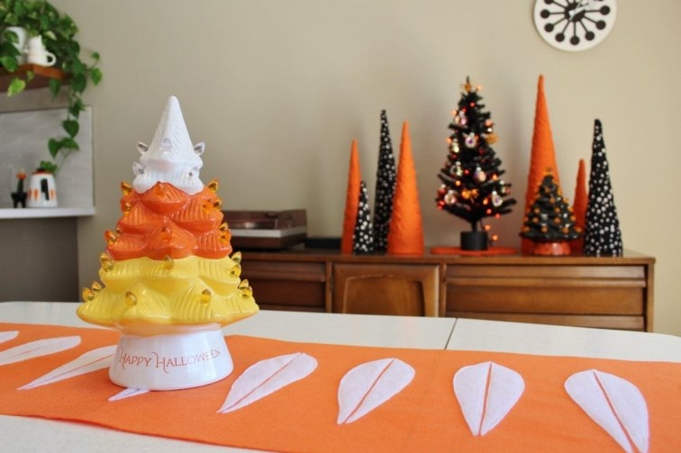 Halloween tree decor with Cathrineholm-inspired table runner