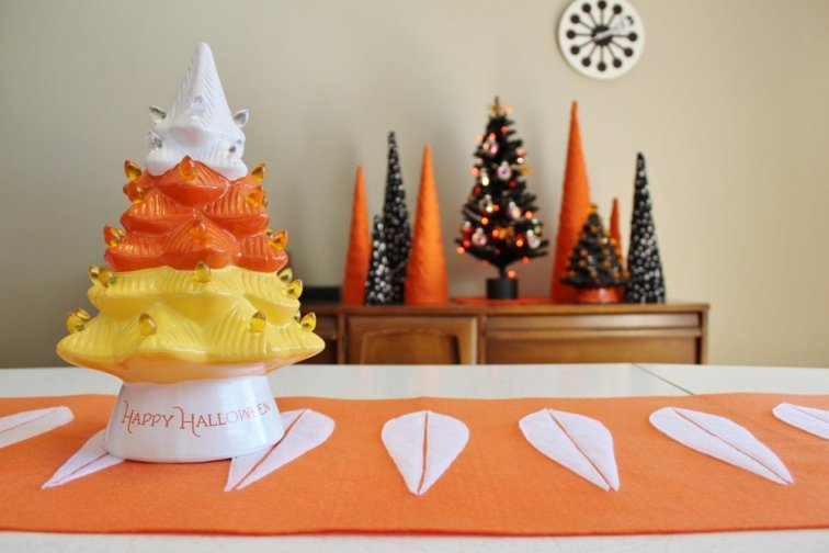 Orange and white lotus table runner with Halloween tree decor