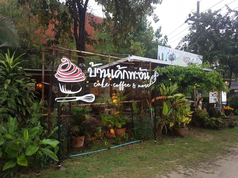 Baancake Phangan sign and cafe outside with green plants around