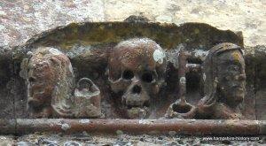 Carving at Soberton churchdepicting pail and key