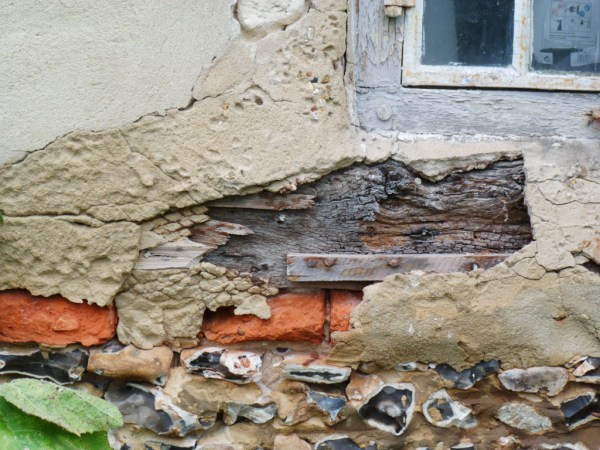 Timber frame cottage before repair
