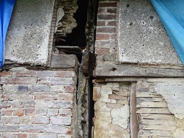 Cottage wattle daub panels before repair