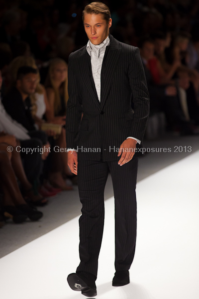 A model on the runway at the Zang Toi SS2013 show at New York Mercedes-Benz Fashion Week.