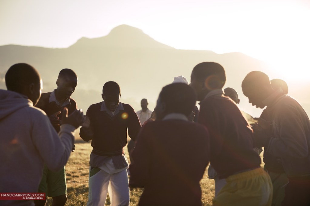 african children huddled together at dawn