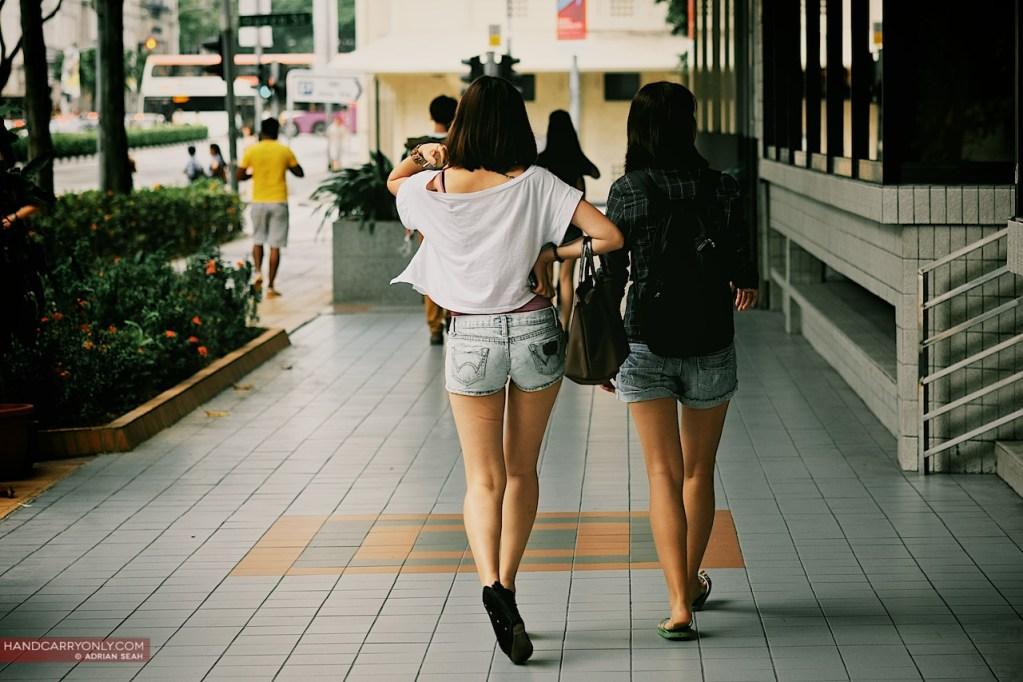 two ladies in shorts walking