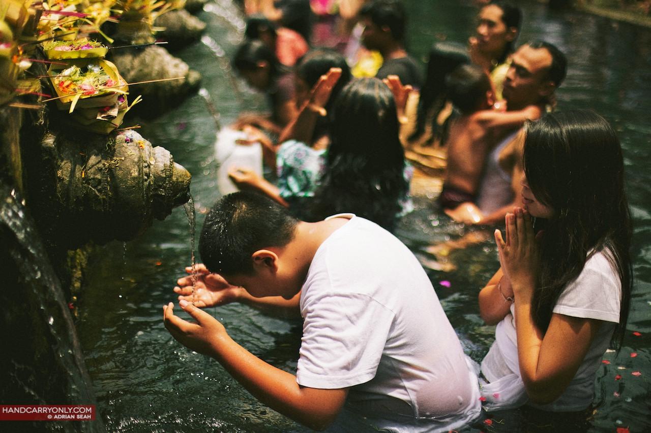 pilgrims praying at tirta empul bali