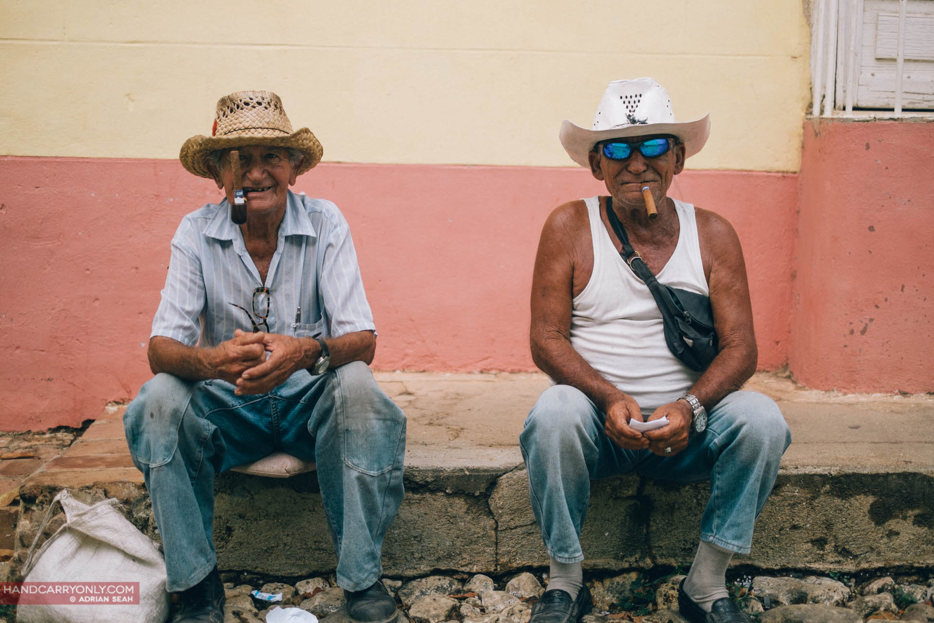 two old men with cigars trinidad cuba