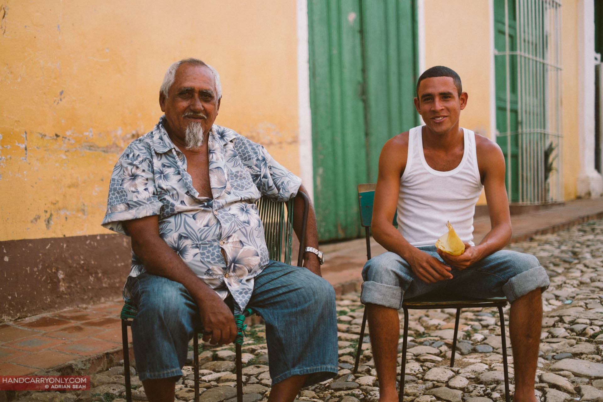 father and son on stool trinidad cuba